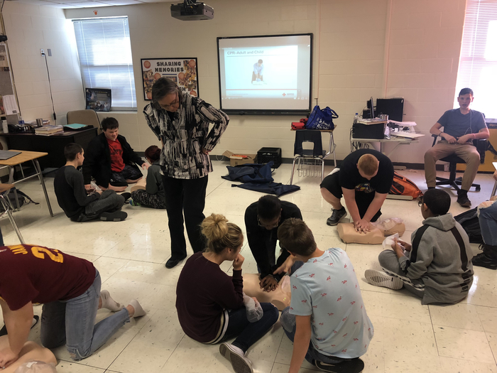 Health class learning CPR